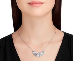 Shimmering in clear crystal with a hint of blue, this rhodium-plated necklace features an on-trend mini frontal silhouette. Its exquisitely crafted... Shop now