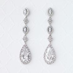 Dazzle your ears with these elongated pear or teardropCZ dangle earrings. These earrings are a fabulous choice for weddings, proms, homecomings or any special