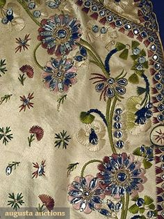 GENTLEMAN'S SILK WAISTCOAT, 18TH C Cream silk satin embroidered all over in small green & brown sprig pattern; collar, pockets & border embroidered w/ floral vinework decorated w/ paste in assorted sizes