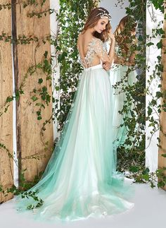Style #1829L from the Papilio Wonderland collection is a short sleeve a-line wedding dress with illusion sweetheart neckline, tulle skirt, and leaf embroidery on top, available in ivory and light green