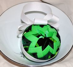 This Shamrock themed quilted ornament is one-of-a-kind and hand made by me with dozens of squares of designer fabric individually folded and pinned in place (using about 150 pins). This ornament measu