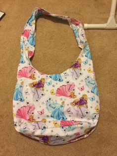 A personal favorite from my Etsy shop https://www.etsy.com/listing/530759341/disney-princess-hobo-bag