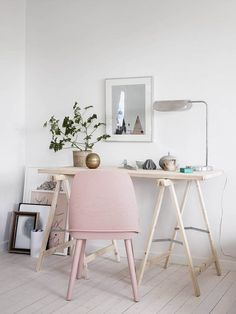 Adorable clean and white home office with a blush pink chair