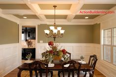 This Dining Room was in the last spec home we built in 2008.  Notice the coffered ceilings and the waincotting.  You can see the Butler's Pantry in the doorway.