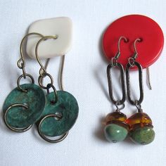 keep-earring-pairs-together in jewelry box with buttons...genius
