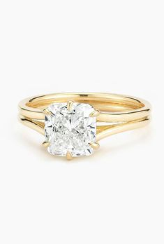 "Brides.com: 66 Yellow Gold Engagement Rings for Every Type of Bride Style 31- V672ERY, ""Ina"" Classic diamond solitaire with surprise diamonds engagement ring, $969 (14K yellow gold setting only), ArtCarvedPhoto: Courtesy of ArtCarved"