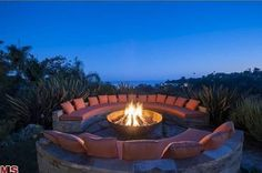 From Zillow's top 10 (Feb 2013) I love this fire pit overlooking the ocean.  Maybe not as comfy as it is purdy but what the heck.