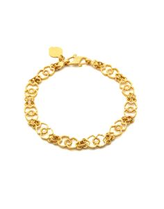 Gold bracelet with intricate design