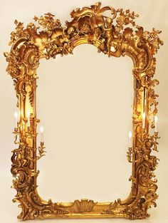 A Monumental Italian 18th/19th Century Baroque Gildwood Carved and Cast-Composition Ornament Figural Mirror with rocaille decoration, crest with open book flanked by putti, sides fitted with putti holding three-branch candle sconces (Fully Restored) All gilding 24 carat gold leaf. Circa: Florence, 1800