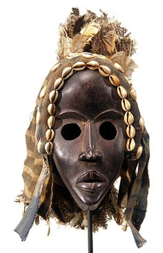 A mask by the Dan people of Ivory Coast and Liberia, Africa.  See The Virtual Artist gallery: www.theartistobjective.com/gallery/index.html