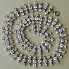 This attractive, quality necklace consists of three rows of lovely sparkling faceted diamante stones.