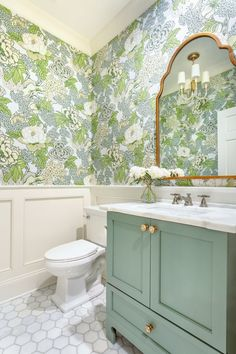 """""""Wainscoting was used to add negative space and balance between the bold paper and green vanity,"""" says designer Lindsey Black of Lindsey Black Interiors. Bad Inspiration, Bathroom Inspiration, Bathroom Inspo, Bathroom Ideas, Bathroom Renos, Small Bathroom, Remodel Bathroom, Girl Bathrooms, Bathroom Modern"""