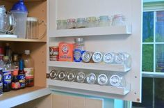 Use wasted cupboard door space to create a DIY storage solution