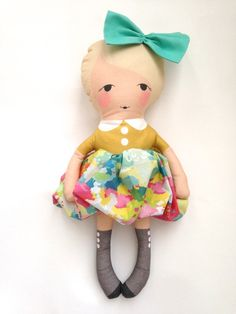 hi, i'm emma. i have blonde hair and pink, rosy cheeks. i have a mustard yellow top and a fun and bright bubble skirt. i LOVE shoes and really love my grey boots, don't you? i love kitty cats and painting my nails. when i grow up i want to have a farm full of horses so i can ride them anytime i w...