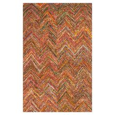 Anchor your patio seating group or define space in the den with this hand-woven cotton rug, featuring a multicolor chevron motif for eye-catching appeal