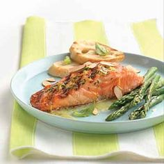 The orange and basil-flavored butter is a nice complement to this grilled salmon entrée.