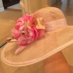 """Beautiful Kentucky Derby hat, brand new, never worn.  Custom made in Louisville, KY, by Dee's Crafts.   Wide brim measures 22"""" in diameter, wire edge that bends stylishly when worn.  Neutral Sinamay hat with silk pink rose flowers, light pink ribbon & tan feather details.  This hat fits a small to medium head."""