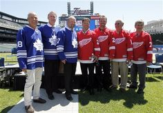 Former Toronto Maple Leafs players from left Jim McKenny, Kevin Maguire and Wendel Clark stand with former Detroit Red Wings players Dino Ciccarelli, Joe Kocur, Alex Delvecchio and Ted Linsday during a news conference at Comerica Park in Detroit, Wednesday, July 11, 2012, announcing the preliminary rosters for the Toronto Maple Leafs-Detroit Red Wings Alumni Showdown hockey game on Dec. 31, 2012,  (AP Photo/Paul Sancya)