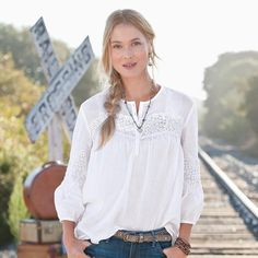 "TENLEY BLOUSE -- Our blouse charms with lace details that rise and fall from the bodice to the billowy sleeves. Cotton voile. Machine wash. Imported. Exclusive. Sizes XS (2), S (4 to 6), M (8 to 10), L (12 to 14), XL (16). Approx. 26""L."
