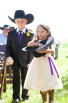 Of course, the flower girl should throw petals from a cowboy hat while the ring bearer is wearing one.