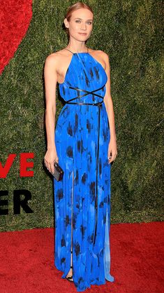 Pleating with a detail of strappy leather belt everything color of blue pretty too  (Michael Kors Collection gown)