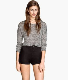 Short sweater in a loose, fine knit with an open, wrap-style back section and long sleeves.