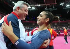 Aly Raisman hugs coach Mihai Brestyan after winning the gold medal in the women's beam. Click to see more great photos (Ronald Martinez / Getty Images)