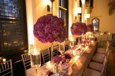Enchanted Castle | Bride and Blossom  Three secrets of stunning wedding tablescapes!    1. Consider Setting: dramatic windows and high ceilings at the Castle Hotel & Spa called for bold, luxe wedding flowers.   2. Create With Color: choose blooms in various tones and texture. We used purple hydrangea, Ocean Song lavender roses and eggplant calla lilies.   3. Layer Height & Light: set low votives and floating candles in stemmed glass among high and low centerpieces.   Photo by Agaton Strom