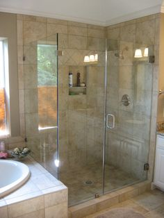 Re-built shower enclosure with heavy frameless glass and recessed caddie.