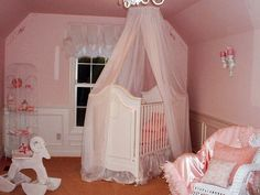 Pink, white and plush all over make this princess nursery stunning. The perfect spot to sing a lullaby! The use of luxurious silks will make any baby feel as if she is sleeping on clouds.