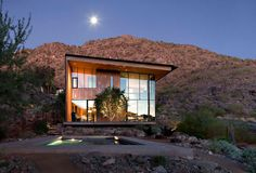 Right here in our very own Phoenix area hides this gorgeous modern home. The exterior featuring weathered steel and copper finish, as well as large 2 story windows. Check out this beautiful design!  by the Jarson Residence in Arizona  http://freshome.com/2012/02/28/embacing-peacefulness-the-modern-jarson-residence-in-arizona/