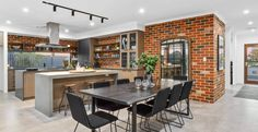 Looking like it belongs on the streets of the West Village, the industrial style furnishings and exposed brick in this display by Ross North Homes is aptly named 'The Manhattan'. Midland Brick, Kitchen Island Bench, Barn Living, Display Homes, Kitchen Themes, Wall Cladding, Clever Design, Home Design Plans, Exposed Brick