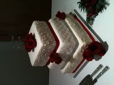 White beaded, red ribbon wedding cake. By renegade cakes