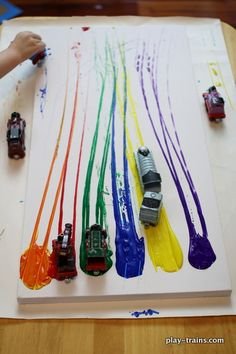 Painting with toy trains on canvas - the little engineer in your life will love this!