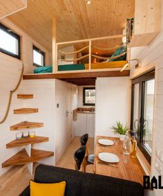 The bedroom loft has a rope railing and built-in dresser.