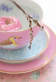 Vintage tea cup with bird & ranunculus