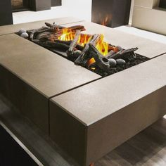 Check out our Quadra firepit with an Optimyst linear flame by @dimplex available through @urban_fireplaces. It's electric and creates a beautiful flame through water vapour! Take the look indoors!   #dreamcastdesigns #firefeatures #luxurylife #fireplace #concrete #concretefirepit #electric #handmade #vancouver