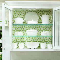 For a low cost cabinet makeover try adding a subtle patterned wall paper to the back of any glass cabinet.