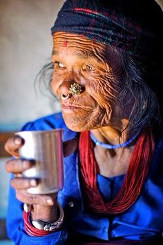 Old Tamang woman drinking tea by Phitar / www.wildcanadasalmon.com for 50% Off Your First Order