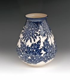 Beautiful handmade and carved blue and white pottery vase by Pineville, Louisiana potter, Ken Tracy.