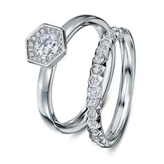 Quite new bridal set by Andrew Geoghegan named Chapiteu in Platinum with colorless diamonds.