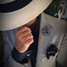 A man who creates his own style with a unique boutonnière can only be regarded as having a certain confidence in himself... Make your own statement with @myboutonniere! #mensaccessories #mfw #gentlemen #menswear #hats #gentlemensclub #class #pochette #cufflinks #luxury