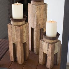 """A fun decoration for any room. This set of 3 candle holders breathes new life into wood that would have otherwise been discarded. Reclaimed wood candle holders - set of 3. Small - 4"""" x 4"""" x 9""""T Medium"""