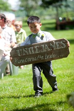 Ringbearer with wooden sign - Katie & James | Wisconsin Barn Wedding at Sugarland by Emily Steffen - via snippetandink