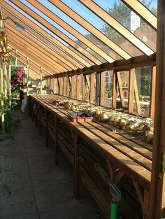 Greenhouse plant shelves. #greenhousedesigndiy Homemade Greenhouse, Lean To Greenhouse, Outdoor Greenhouse, Cheap Greenhouse, Greenhouse Gardening, Greenhouse Ideas, Greenhouse Shelves, Greenhouse Wedding, Portable Greenhouse