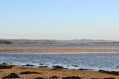 Looking over the bay towards the Cheviot Hills