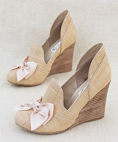 Cute wedge shoes with bows.