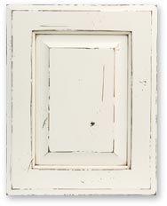 Raised Panel Distressed White Cabinet