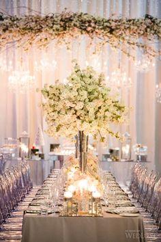 These Cherry Blossom centerpieces are breathtaking. | Photography: Ikonica | Floral Design: Rachel A Clingen | #fourseasons #Toronto #weddings #fsweddings #bridal #springwedding #spring #cherryblossom