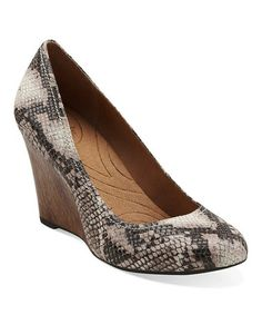 Okay, I am seeing a theme here. Apparantly I need a pair of snake shoes. This Beige Purity Snow Leather Wedge is perfect! #zulilyfinds